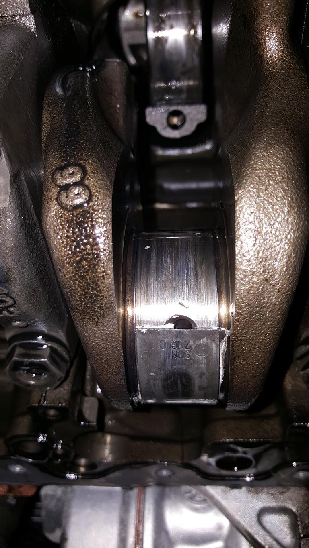 Motor distrus ca urmare a cedarii simeringului axei cu came - Passat